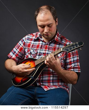 Portrait Of Musician With Mandolin