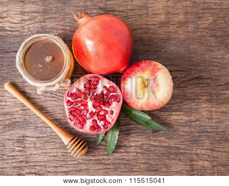 Isolated Honey, Apple And Pomegranate For Traditional Holiday Hashanah
