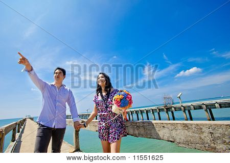 Bride Looking At Groom Pointing For Future Concept