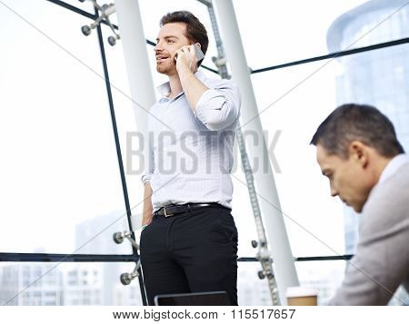 Business Person Talking On Cellphone In Office