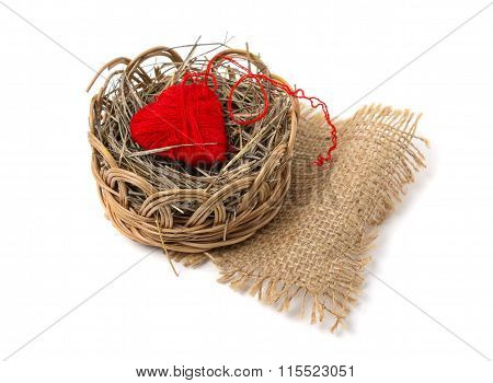 Heart Of Yarn In A Wicker Basket Isolated On White Background