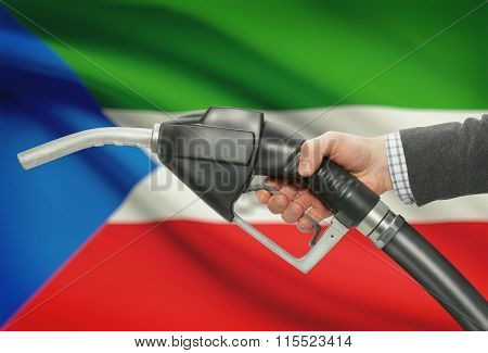 Fuel Pump Nozzle In Hand With National Flag On Background - Equatorial Guinea