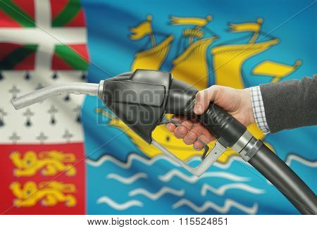 Fuel Pump Nozzle In Hand With National Flag On Background - Saint Pierre And Miquelon