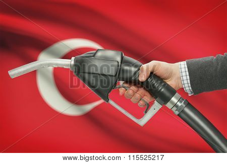 Fuel Pump Nozzle In Hand With National Flag On Background - Turkey