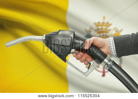 Fuel Pump Nozzle In Hand With National Flag On Background - Vatican City State