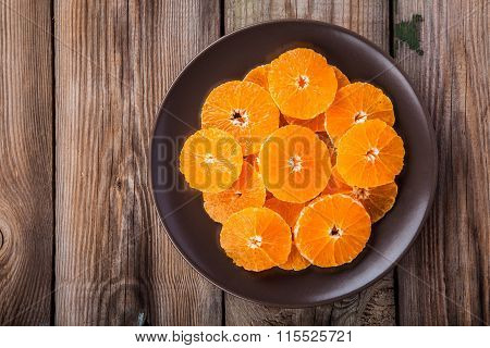 Organic Fresh Juicy Tangerine Slices On A Plate