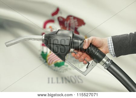 Fuel Pump Nozzle In Hand With Usa States Flags On Background - Illinois
