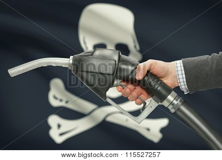 Fuel Pump Nozzle In Hand With Flags On Background Series - Jolly Roger - Symbol Of Piracy