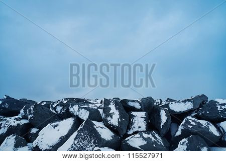 Snowy Rocks And Cloudy Clean Sky