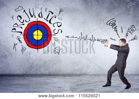 Businessman holding painted gun