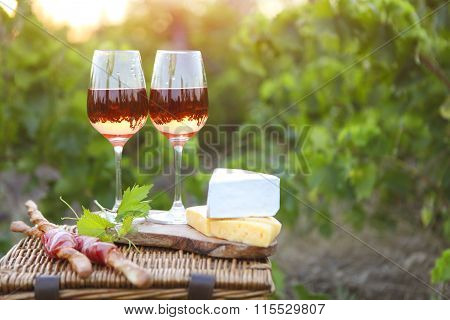 Two Glasses Of Rose Wine With Bread, Meat, Grape And Cheese
