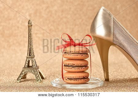 Macarons. Luxury shiny shoes, Eiffel Tower on gold