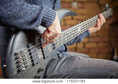 Musician Playing A Bass Guitar In Club