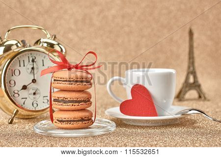 Macarons.Gold alarm clock, red heart,cup of coffee