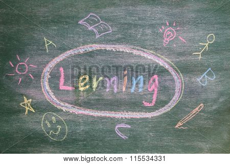 lerning write on chalkboard with color chalk