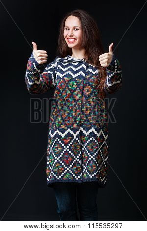 Emotions, Expressions. Young Brunette Woman In Bright Sweater Smiling, Thumbs Up