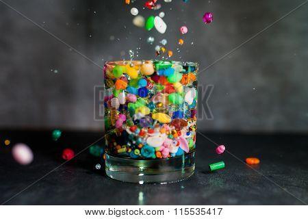 the glass, water, light, beads, fall, a scattering, color, sides, bubbles
