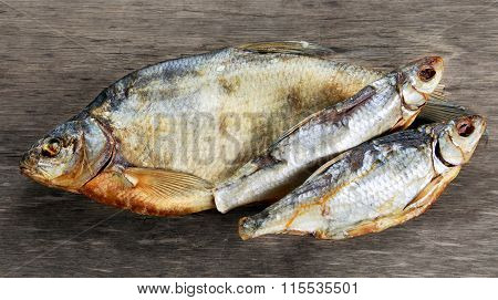 Salted Dry fish vobla on wooden table