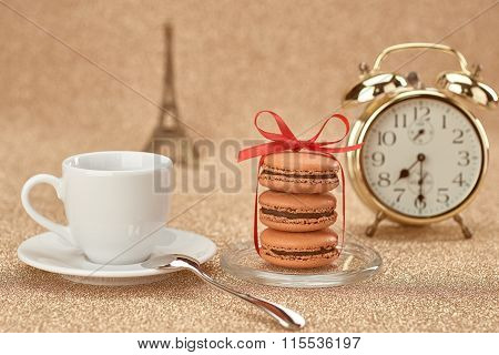Macarons.Gold alarm clock, cup coffee,Eiffel Tower