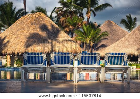Swimming Pool With Beach Chairs In Tropical Resort, Dominican Republic