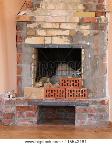 Building a traditional fireplace from bricks in ukrainian house