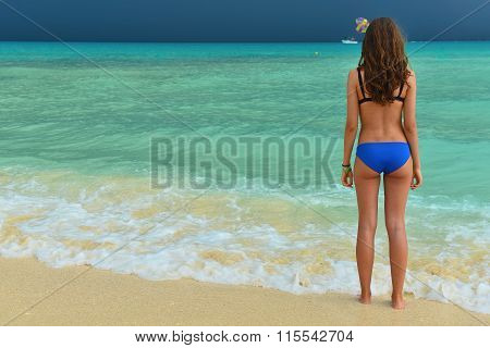 Beautiful Girl In A Swimsuit On The Tropical Sea. Woman With A Beautiful Figure In Swimsuit On The B