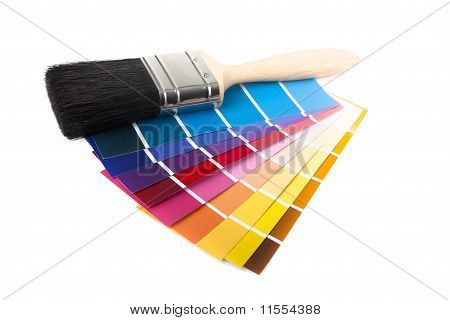 Paint Brush And Multi Coloured Swatches
