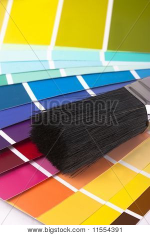 Paint Swatches And Paintbrush Close Up