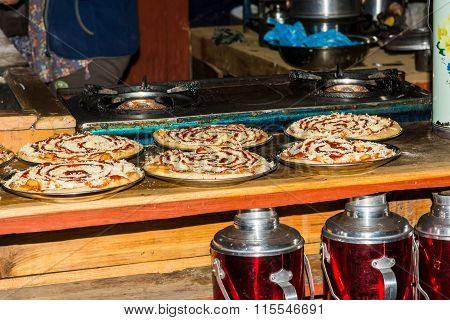 Pizzas ready to be backed.