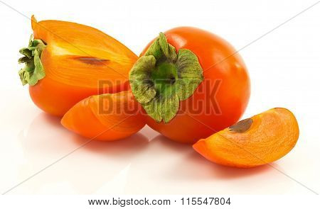 Group Of Ripe Fresh Persimmons With Slices