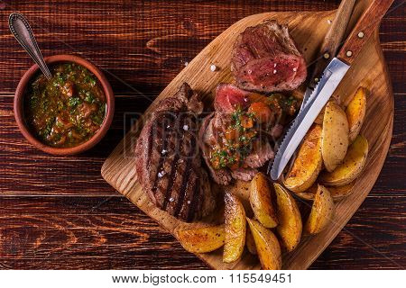 Grilled Steak With Potato Wedges, Salsa And Spices.