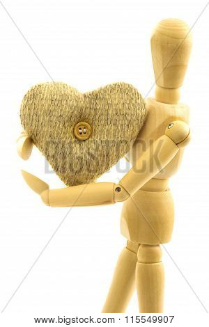 Macro View Of Wooden Male Person With Knitted Woolen Heart With Button