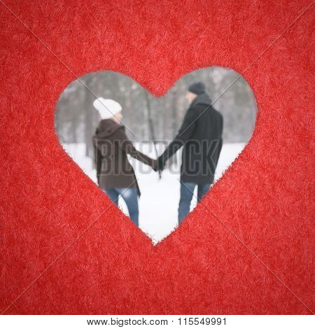 Loving couple walking in the park. Frame in form of decorative heart. Photo in defocusing