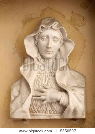 FLORENCE, ITALY - JUNE 05: Our Lady of Sorrows on the house facade in Florence, Italy, on June 05, 2015
