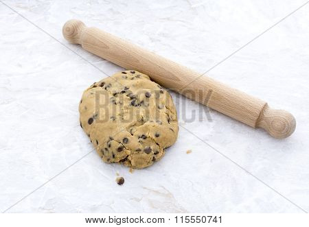 Ball Of Chocolate Chip Cookie Dough With Rolling Pin