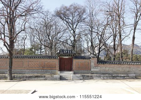 Gyeongbok Palace Brick Wall And Branch Dry Tree Garden Historic  In Korea