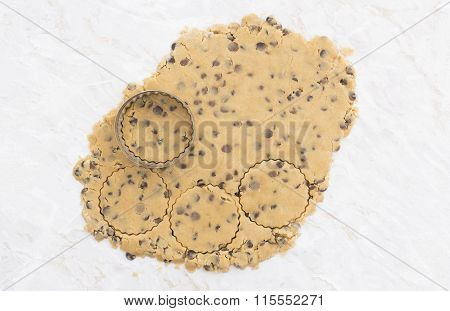 Circles Being Cut From Rolled Out Cookie Dough