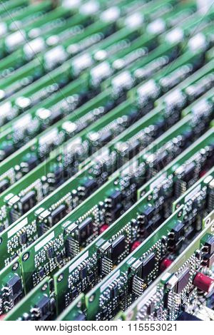Lots Of Printed Circuit Boards With Mounted And Soldered Componentry Arranged In Rows Together