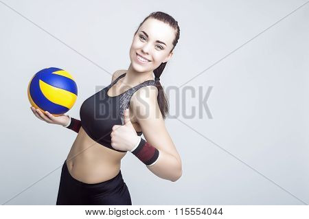 Sport Concepts And Ideas. Professional Female Volleyball Athlete With Ball Showing Thumbs Up Sign