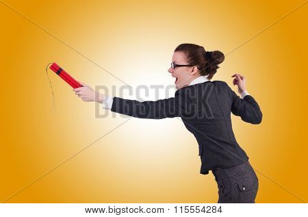 Businesswoman with dynamite against the gradient