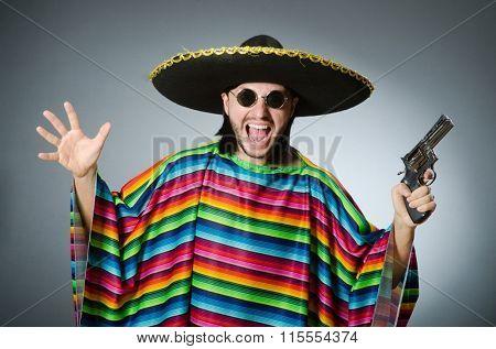Mexican with gun wearing sombrero