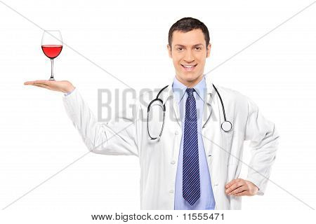 A Medical Doctor Holding A Glass Of Wine