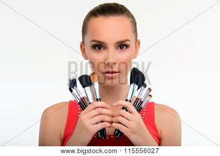 Visagiste with set of make-up brushes.