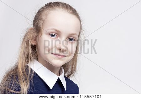 Beautiful Caucasian Blond Girl With Wonderful Deep Eyes. Posing Against White.