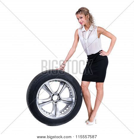 Young professional woman with car wheels. Caucasian businesswoman isolated on white background