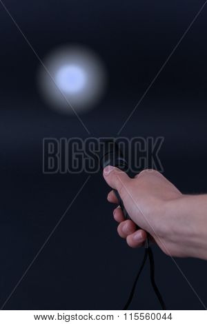 Led Flashlight With A Light Beam In Hand