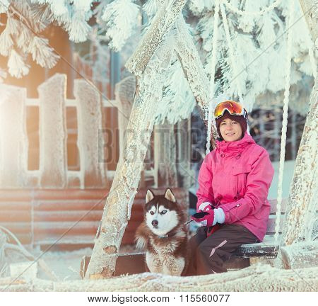 Portrait of a pretty young woman with dog