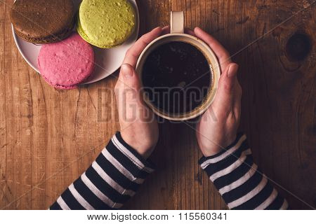 Hot Cup Of Coffee And Macaron Cookies