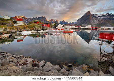 Norway Coast With Boat And Red Huts, Reine