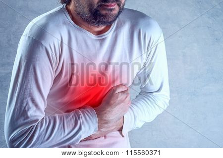 Man Suffering From Severe Abdominal Pain, Hands On Stomach